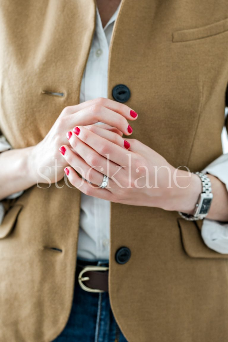 Vertical stock photo of a woman's hands.