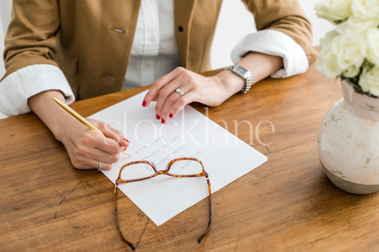 Horizontal stock photo of woman writing.