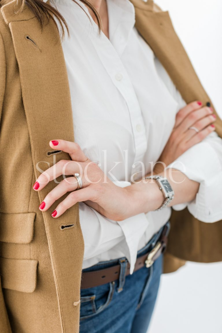 Vertical stock photo of stylish woman wearing a blazer.