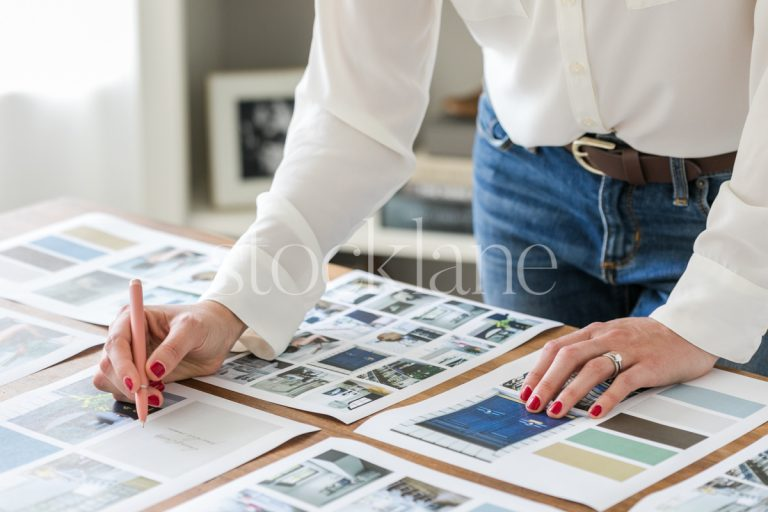 Horizontal stock photo of a woman working on a mood board.