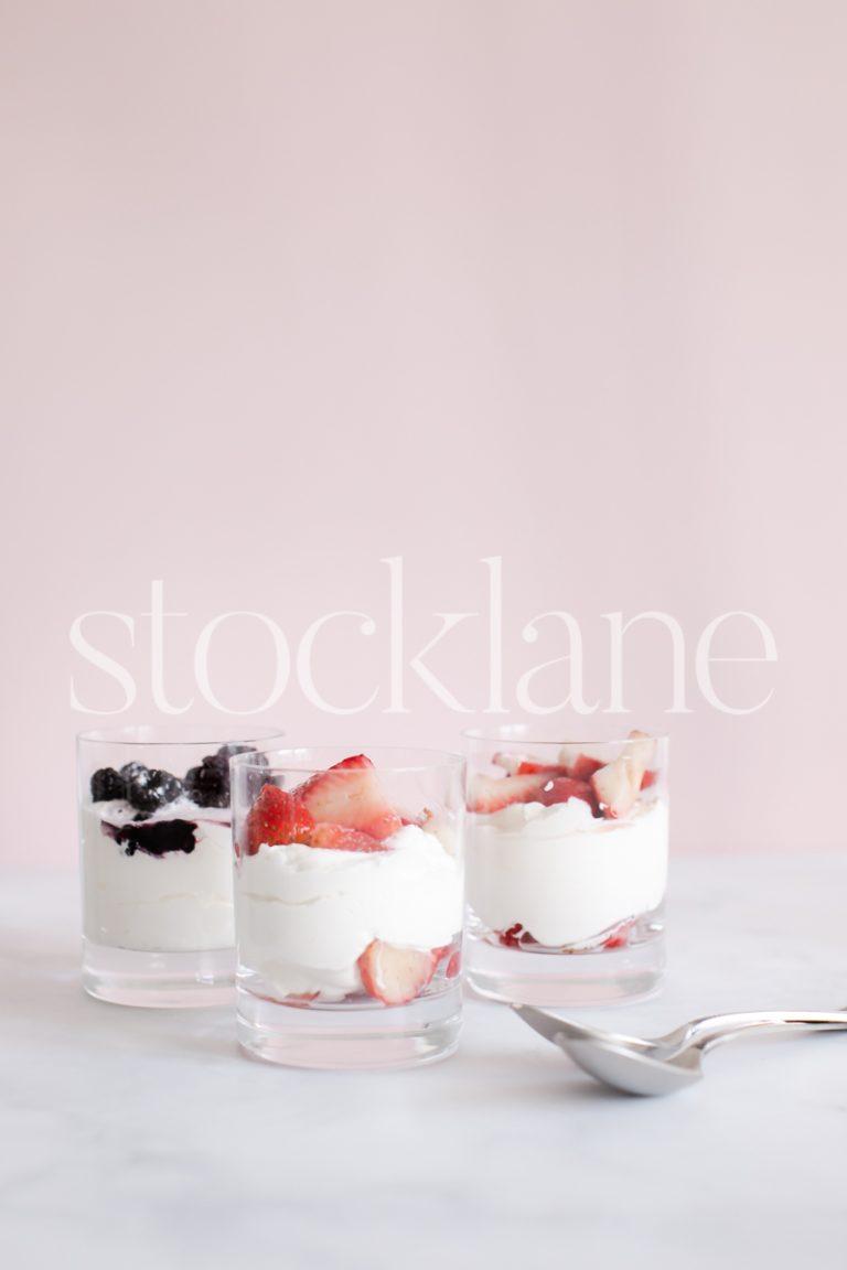 Vertical stock photo of berries and cream desert