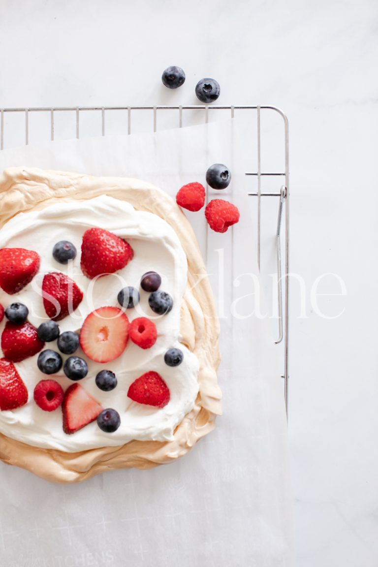 Vertical stock photo of a pavlova with berries