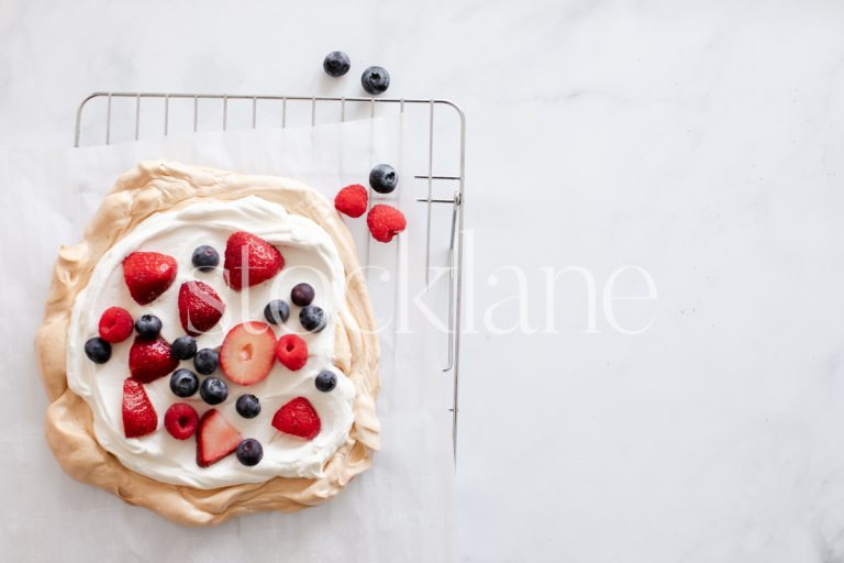 Horizontal stock photo of a pavlova with berries