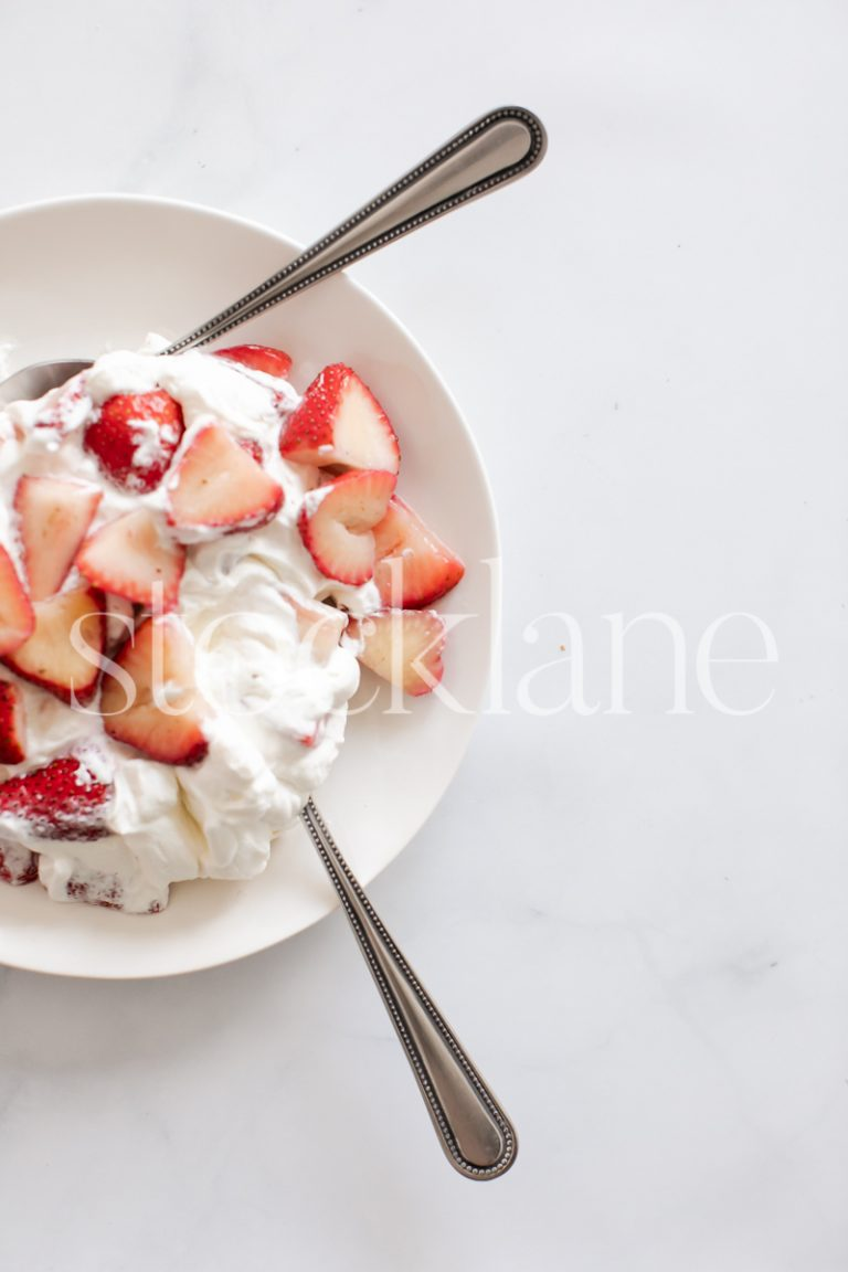 Vertical stock photo of strawberries and cream