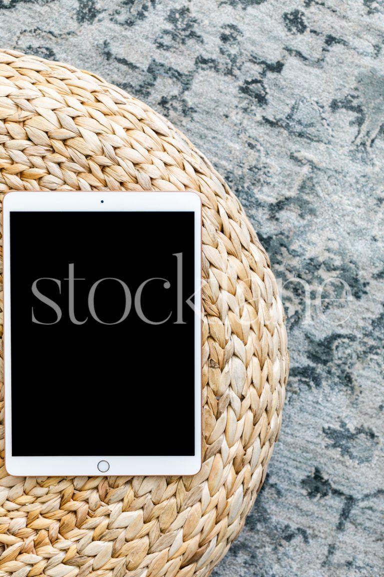 Vertical stock photo of an iPad.