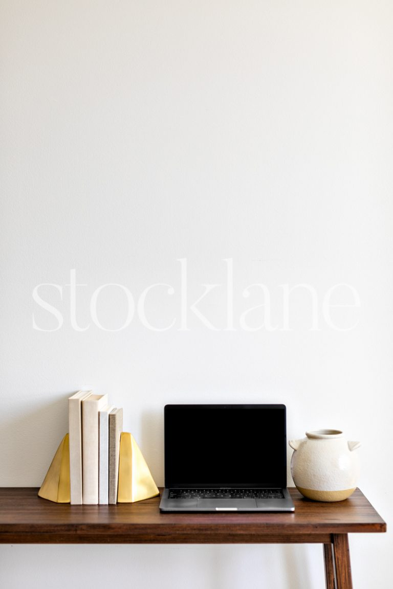 Vertical stock photo of a computer mockup in neutral colors.