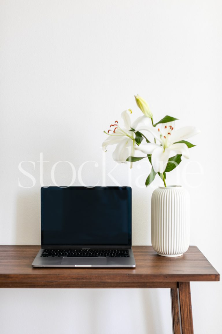Vertical Stock photo of white asian lilies and a computer