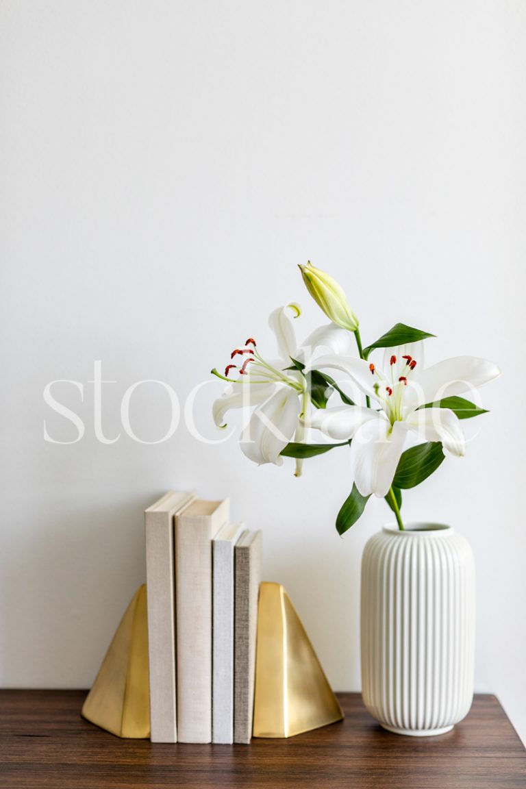 Vertical Stock photo of white Asian Lilies and books