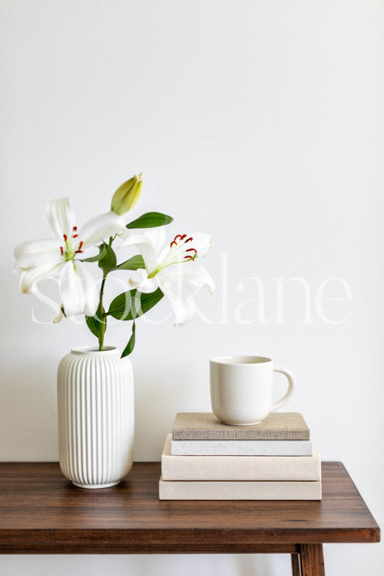 Vertical Stock photo of white asian lilies and books with coffee