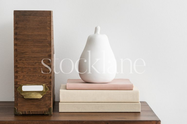 Horizontal stock photo of a desktop in neutral and pink colors.
