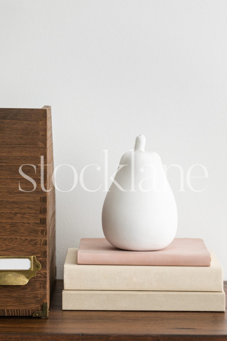 Vertical stock photo of a desktop in neutral and pink colors.