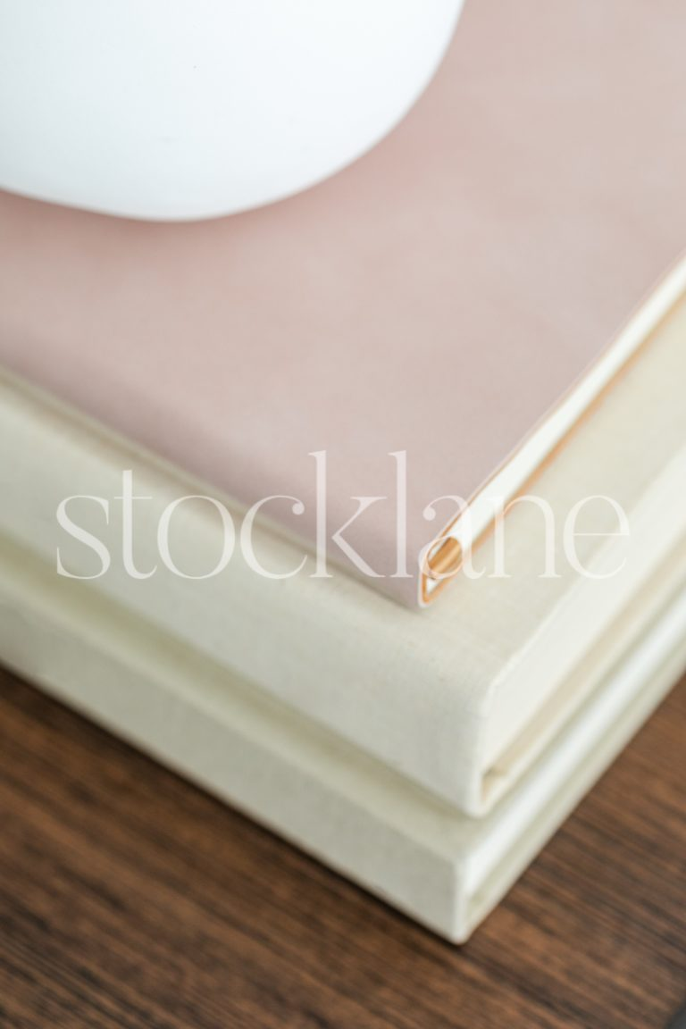 Vertical stock photo of a stack of books.