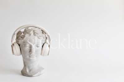 Horizontal stock photo of a woman head sculpture with headphones